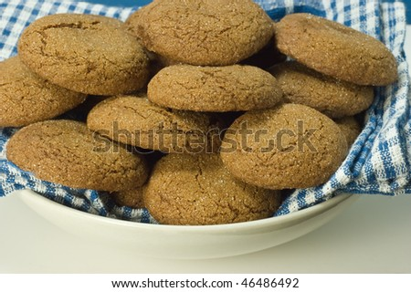 Plate of fresh baked gingersnap cookies with shallow depth of field