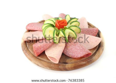 plate of fresh cold meats and vegetables - stock photo