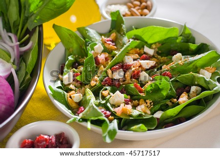 plate of fresh colorfull spinach salad close up