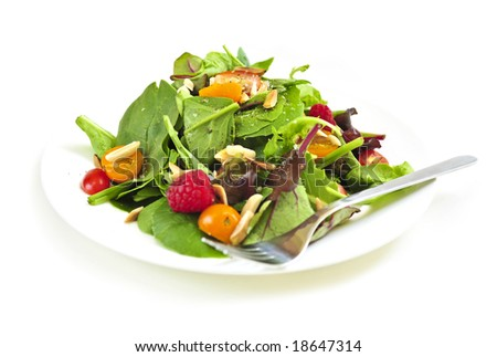 Plate of fresh green salad isolated on white background
