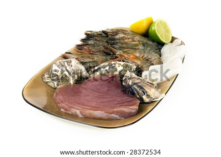 Plate of fresh seafood against white background