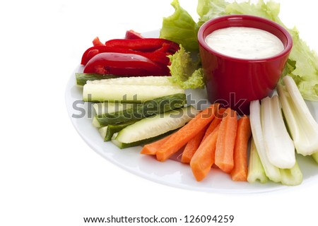plate of fresh vegetables and dip ipisolated on white background