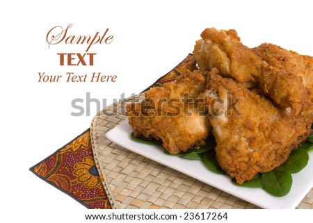 Plate of Fried Chicken over white background with copy space for text