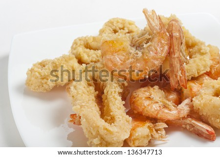 plate of fried fish, closeup on white background