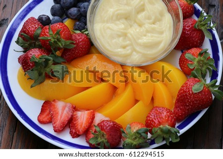 Plate of fruit with dipping cream