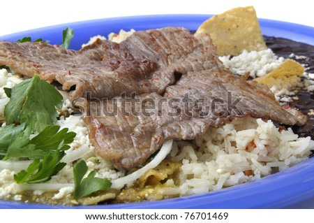 Plate of grilled beef with rice, black beans, tortilla and salsa