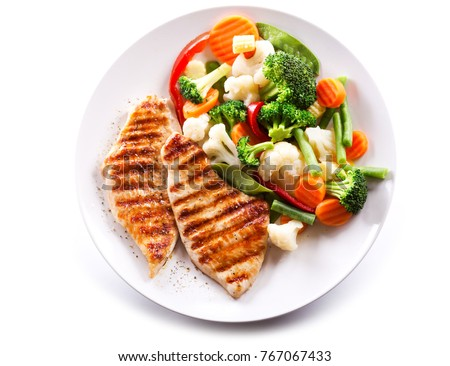 plate of grilled chicken with vegetables isolated on white background #767067433