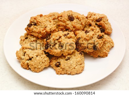 Plate of healthy oatmeal raisin cookies fresh from the oven