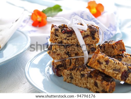 Plate of homemade muesli bars wrapped with a bow.
