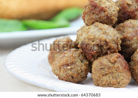 Plate of meatballs without sauce. Shallow depth of field.