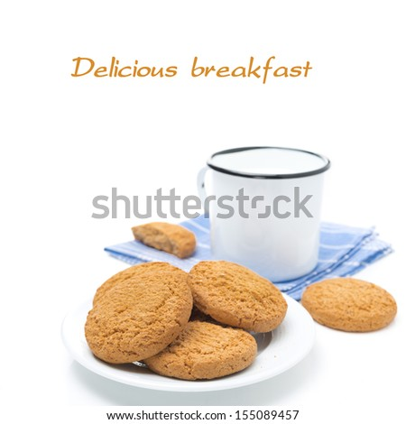 plate of oatmeal cookies and mug of milk isolated on white