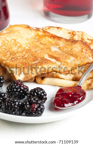 Plate of pancakes with fresh blackberries - stock photo