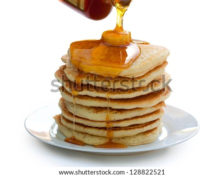 Plate of pancakes with syrup and butter. Isolated on white.