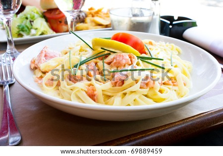 plate of pasta and smoked salmon with tomato