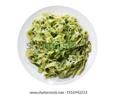 plate of pasta with pesto sauce isolated on a white background, top view Zdjęcia stock ©