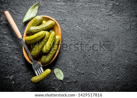 Plate of pickled homemade cucumbers. On black rustic background Сток-фото ©