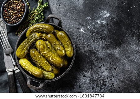 Plate of pickled homemade cucumbers, pickles. Black background. Top view. Copy space Сток-фото ©