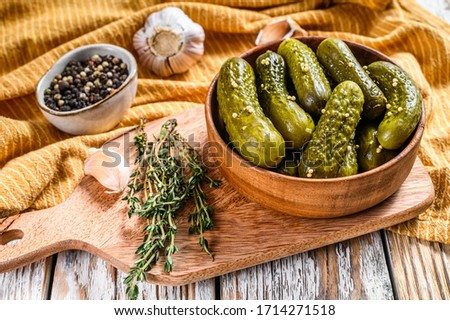 Plate of pickled homemade cucumbers, pickles. White background. Top view Сток-фото ©