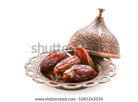 Plate of pitted dates isolated on a white background. #1083262034