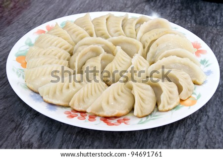 Plate of Potstickers Chinese Pork Dumplings Asian Appetizer Dish