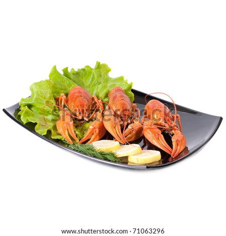 Plate of red boiled lobsters with fresh lettuce. Luxury diet meal