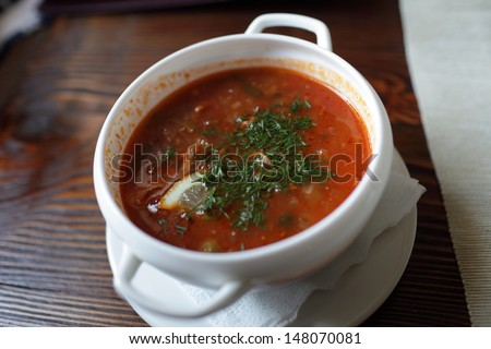 Plate of red soup in the russian restaurant