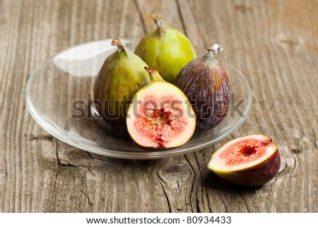 Plate of Ripe Fig Fruits on old wooden table