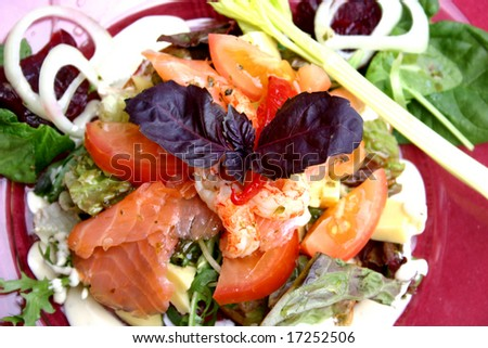 Plate of seafood salad topped with basil