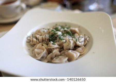 Plate of siberian pelmeni in a russian restaurant