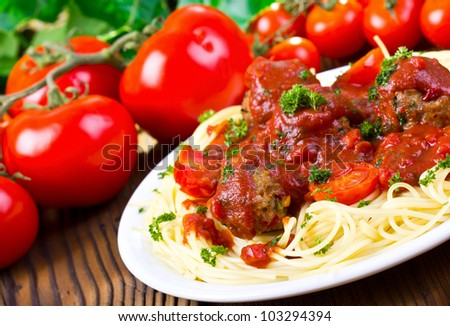 Plate of spaghetti with meatballs in tomato sauce