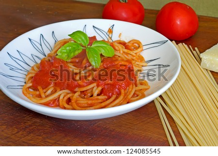 plate of spaghetti with sauce and basil