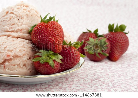 plate of strawberry ice cream with strawberry