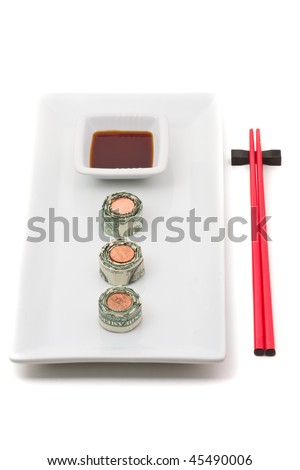 Plate of sushi made from money over white background