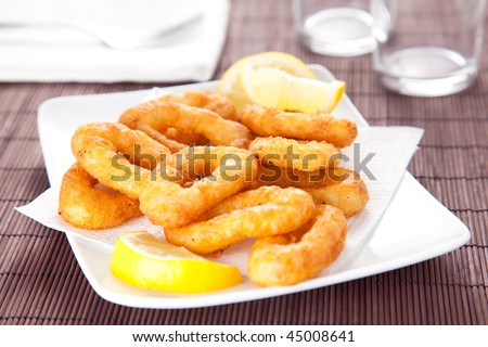 plate of tasty fried calamari with lemon