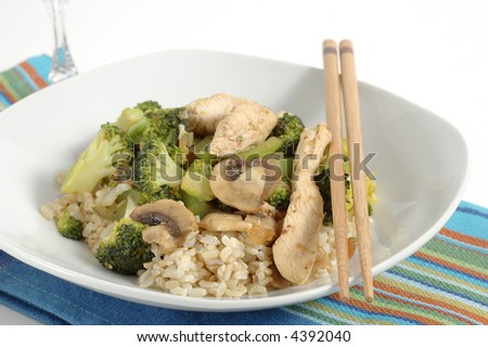 Plate of tasty orange chicken stirfry with broccoli.