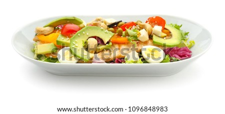 Plate of tasty salad with ripe avocado on white background #1096848983