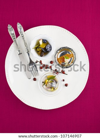 Plate with appetizer, studio shot