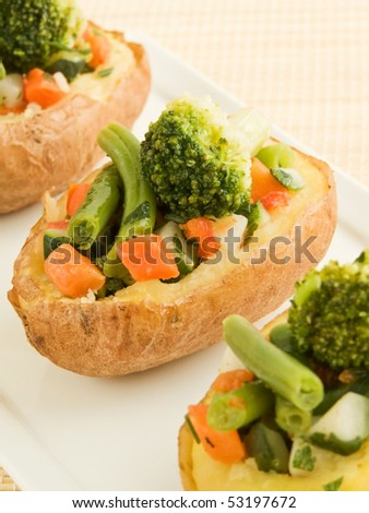 Plate with baked potatoes stuffed with vegetables. Shallow dof.