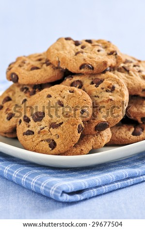 Plate with big pile of chocolate chip cookies