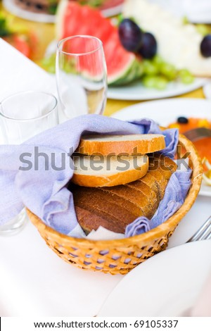 plate with Bread on restaurant table before party - stock photo