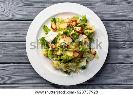 Plate with chicken salad on table #623737928