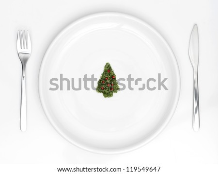 plate with christmas tree of sliced �¢??�¢??onion and red pepper