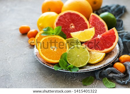 Plate with citrus fresh fruits on a concrete background Сток-фото ©