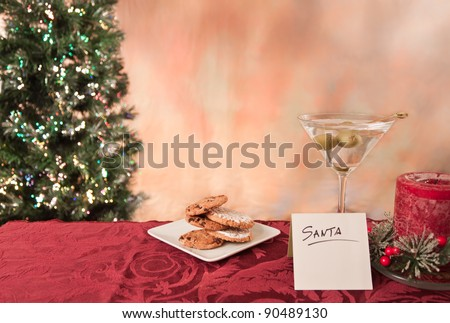 plate with cookies and a martini with olives for santa claus