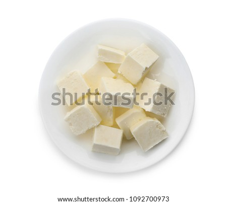Plate with cubes of tasty fresh butter on white background, top view #1092700973