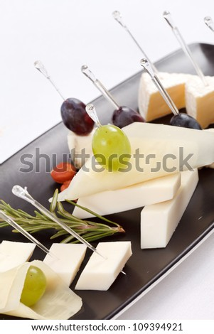 plate with different types cheese - stock photo