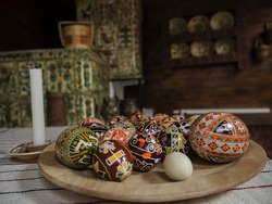 Plate with eastern eggs with the traditional designs in Ukranian house