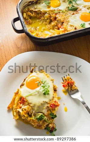 plate with eggs fried with parsley on top of cooked rice meal