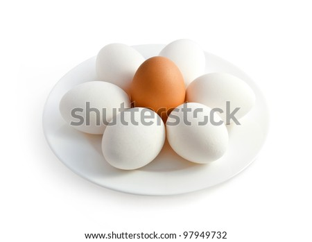 Plate with eggs on white background