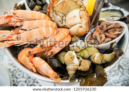 Plate with fresh assorted seafood in french summer restaurant. Close up image Photo stock ©